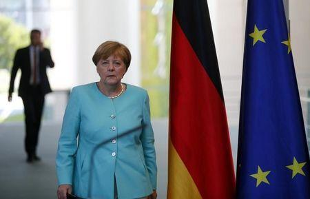 German Chancellor Merkel arrives for a statement in Berlin