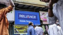 Reliance Communications Extends Gain on Asset Sale Signals