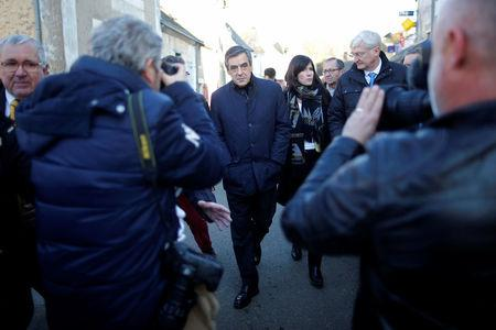 Francois Fillon, member of Les Republicains political party and 2017 presidential candidate of the French centre-right, walks in the street in Chantenay-Villedieu, western France
