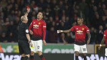 Twitter rejoices Mike Dean's 100th red card