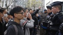 Angry protesters clash with police in Paris