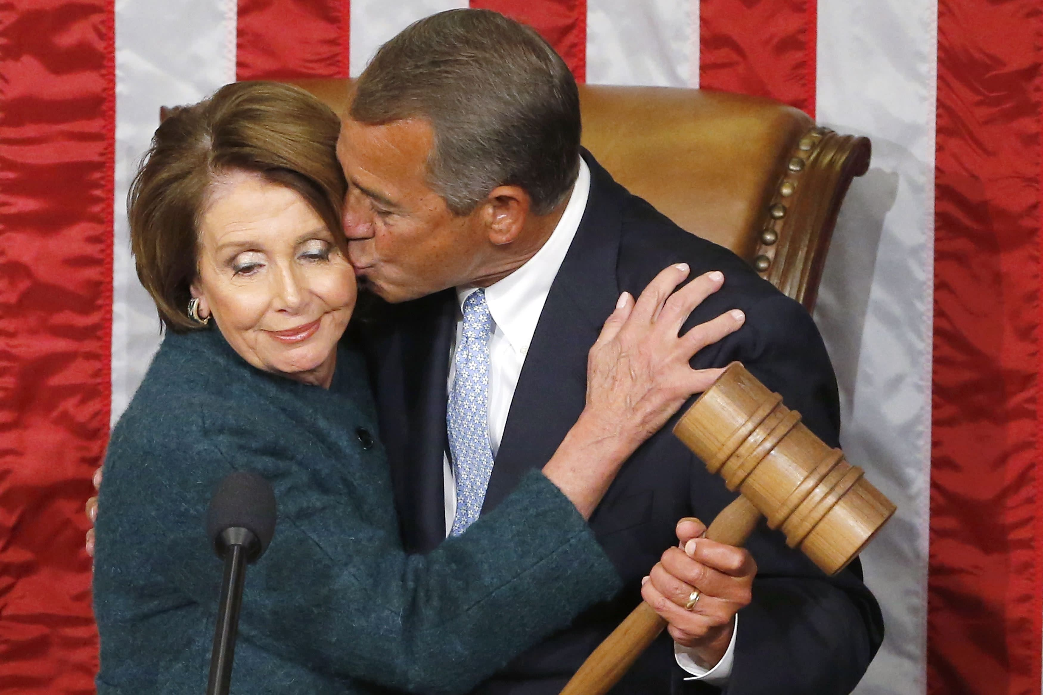 U.S. House Speaker John Boehner (R-OH) (R) kisses House Minority Leader Nancy Pelosi (D-CA), as he holds the gavel after being re-elected speaker on the House floor at the U.S. Capitol in Washington January 6, 2015. REUTERS/Jonathan Ernst (UNITED STATES - Tags: POLITICS TPX IMAGES OF THE DAY)