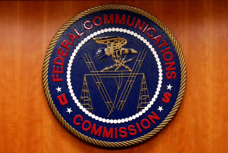 FILE PHOTO: The Federal Communications Commission (FCC) logo is seen before the FCC Net Neutrality hearing in Washington