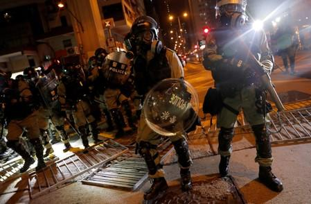 FILE PHOTO: Riot police go through the barricade as they search for anti-government protesters in Hong Kong