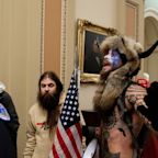 Lawyer for the 'Q Shaman' who stormed the Capitol in a fur headdress with horns says his client feels 'duped' after Trump didn't pardon him
