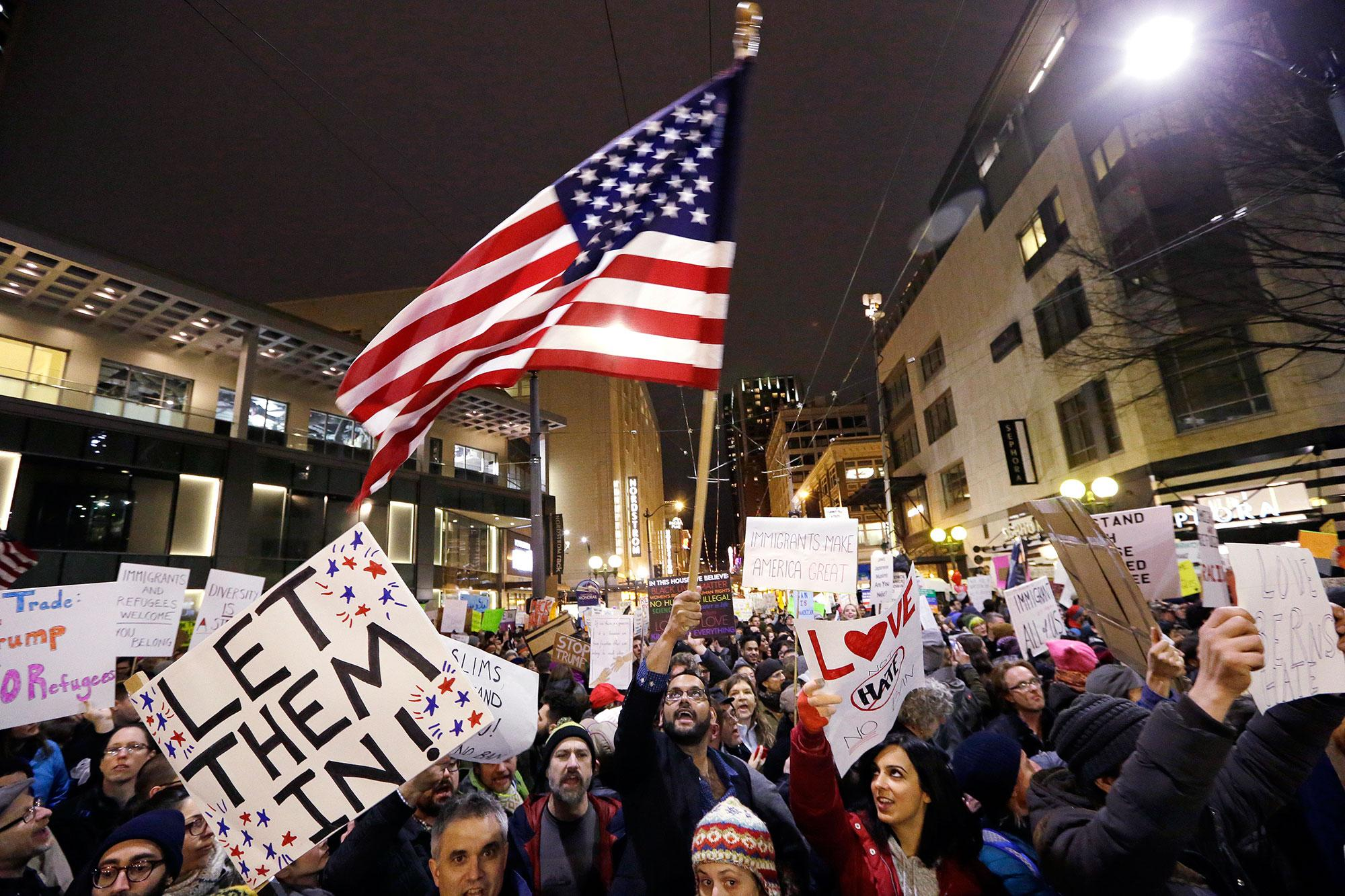<p>People cheer during a rally to oppose President Donald Trump's executive order barring people from certain Muslim nations from entering the United States, Sunday, Jan. 29, 2017, in downtown Seattle. (AP Photo/Elaine Thompson) </p>