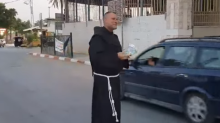 Priest Gives Away Food and Water for Muslims Breaking Ramadan Fast in West Bank
