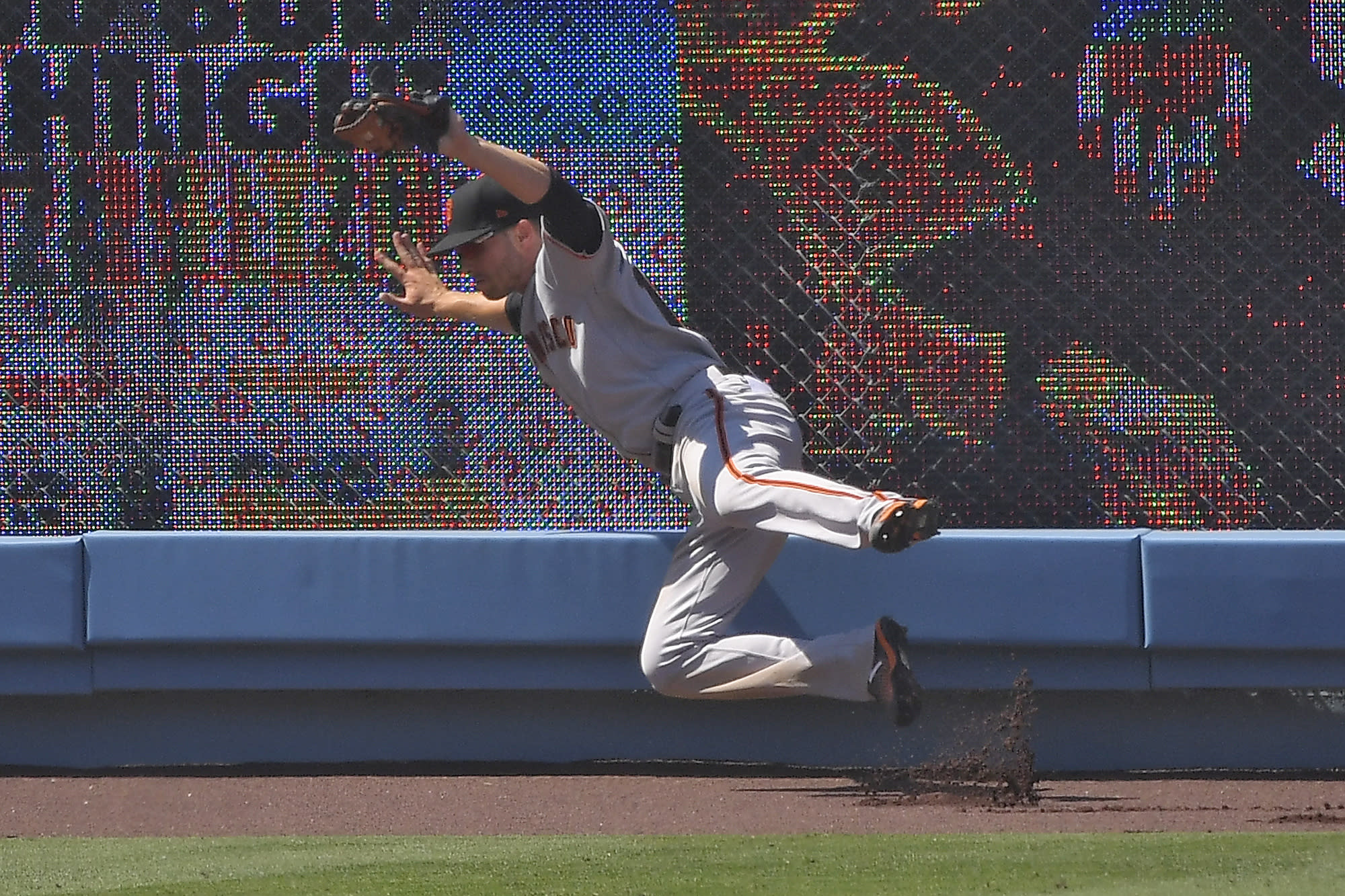San Francisco Giants left fielder Austin Slater makes a catch on a ball hit by Los Angeles Dodgers' Corey Seager during the sixth inning of a baseball game Saturday, July 25, 2020, in Los Angeles. (AP Photo/Mark J. Terrill)