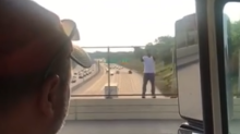 2 beer delivery drivers talk a suicidal man down from a bridge by cracking open a 12-pack