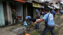 As battle rages, devastated Philippine city starts its long cleanup