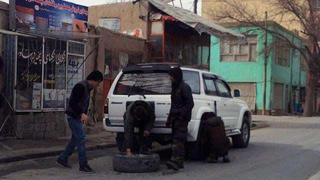 Afghan Police Slash Tires To Deter Car Theft
