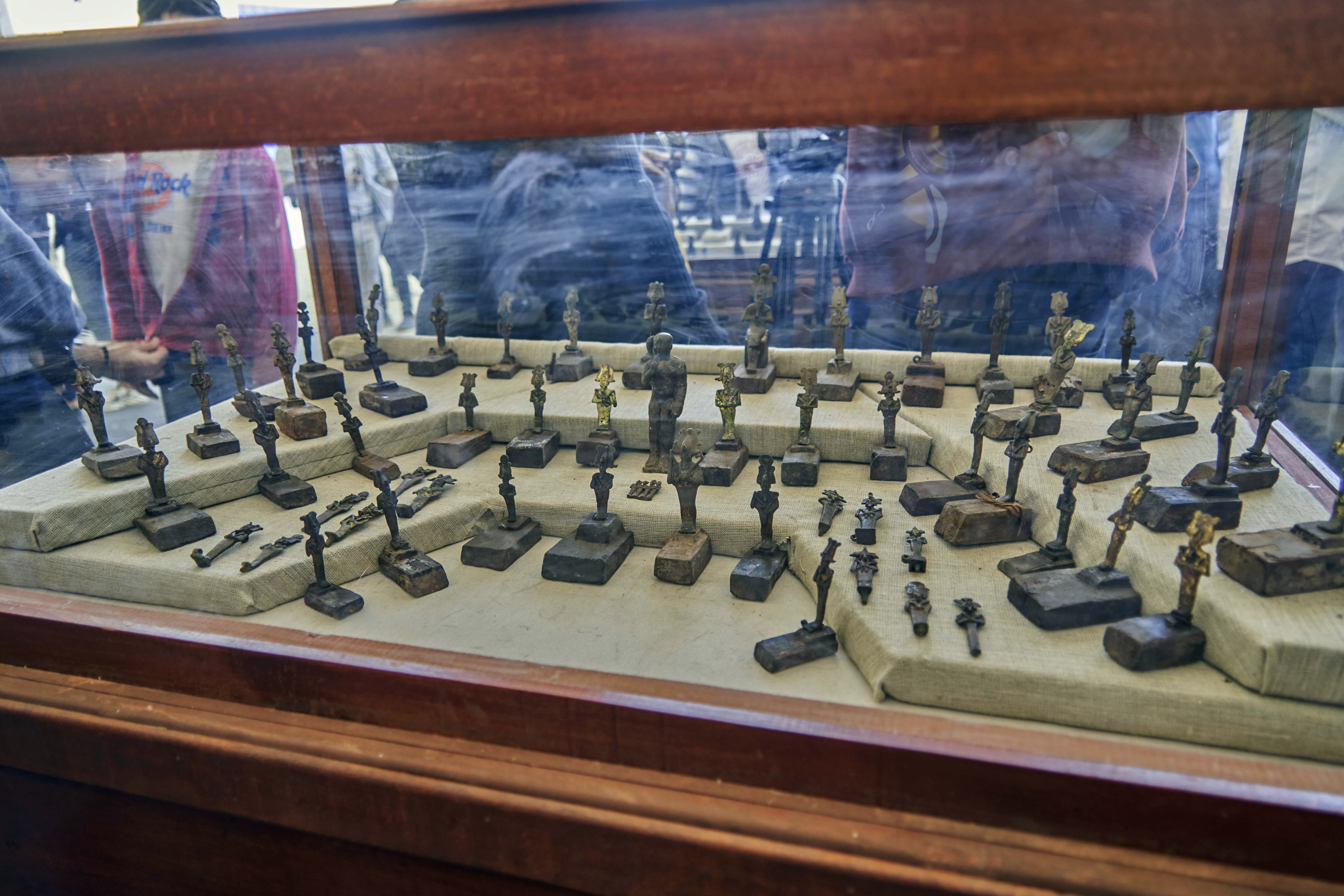73 bronze statuettes depicting god Osiris are displayed in Saqqara, south Giza, Egypt. Saturday, Nov. 23, 2019. Egypt's Ministry of Antiquities revealed details on recently discovered animal mummies, saying they include two lion cubs as well as several crocodiles, birds and cats. The new discovery was displayed at a makeshift exhibition at the famed Step Pyramid of Djoser in Saqqara, south of Cairo, near the mummies and other artifacts were found in a vast necropolis. (AP Photo/Hamada Elrasam)
