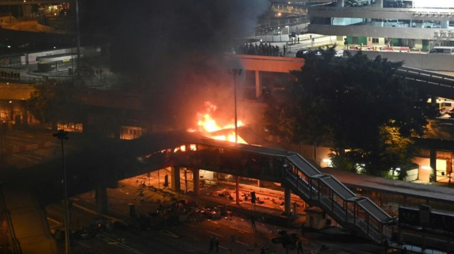 Hong Kong protests intensify, fire holds off police