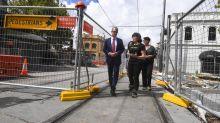 Labor promises cash for light rail victims