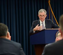 Fed cuts interest rates, divided over future moves