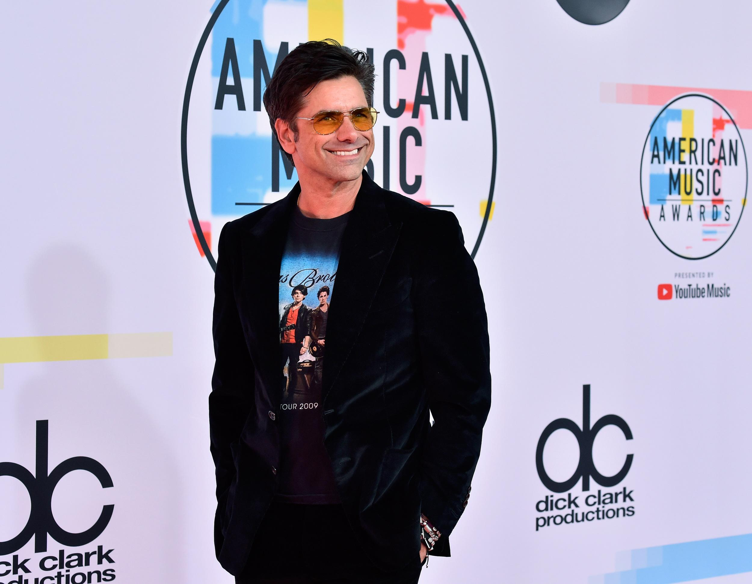 LOS ANGELES, CA - OCTOBER 09: John Stamos attends the 2018 American Music Awards at Microsoft Theater on October 9, 2018 in Los Angeles, California. (Photo by Frazer Harrison/Getty Images)