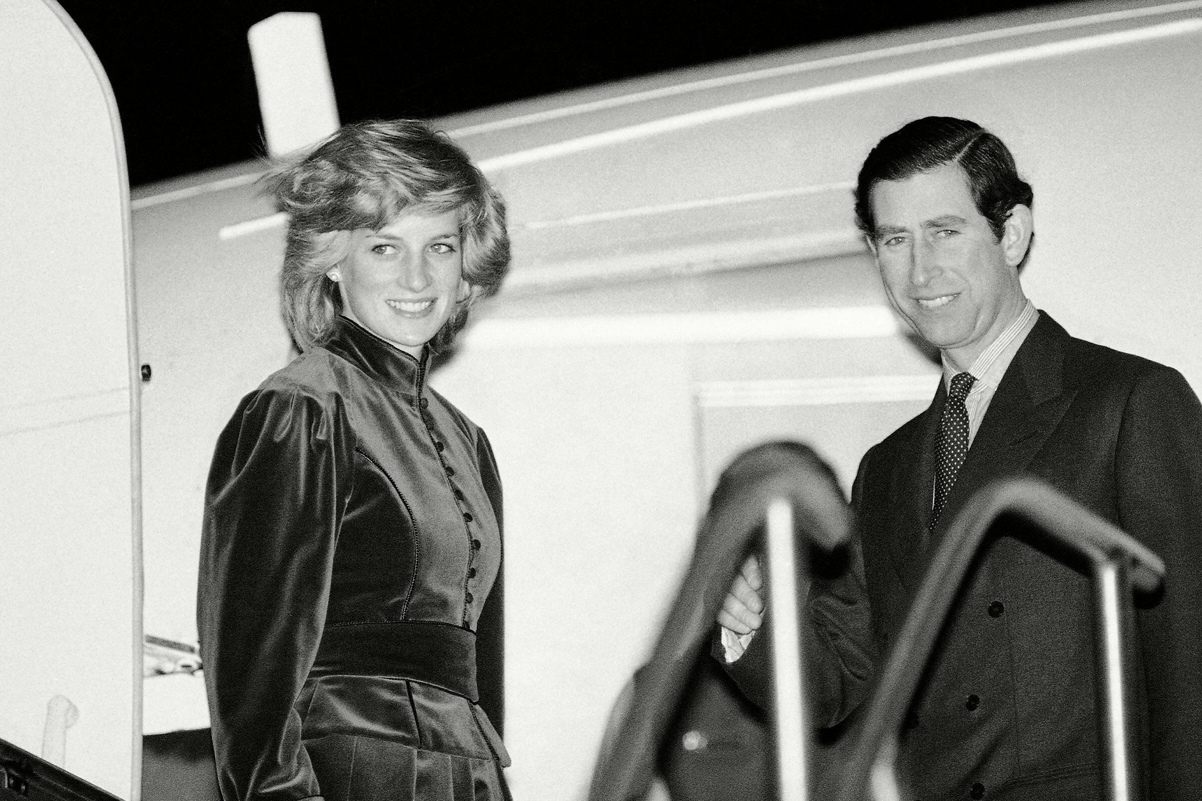 Charles and Diana boarding a flight.