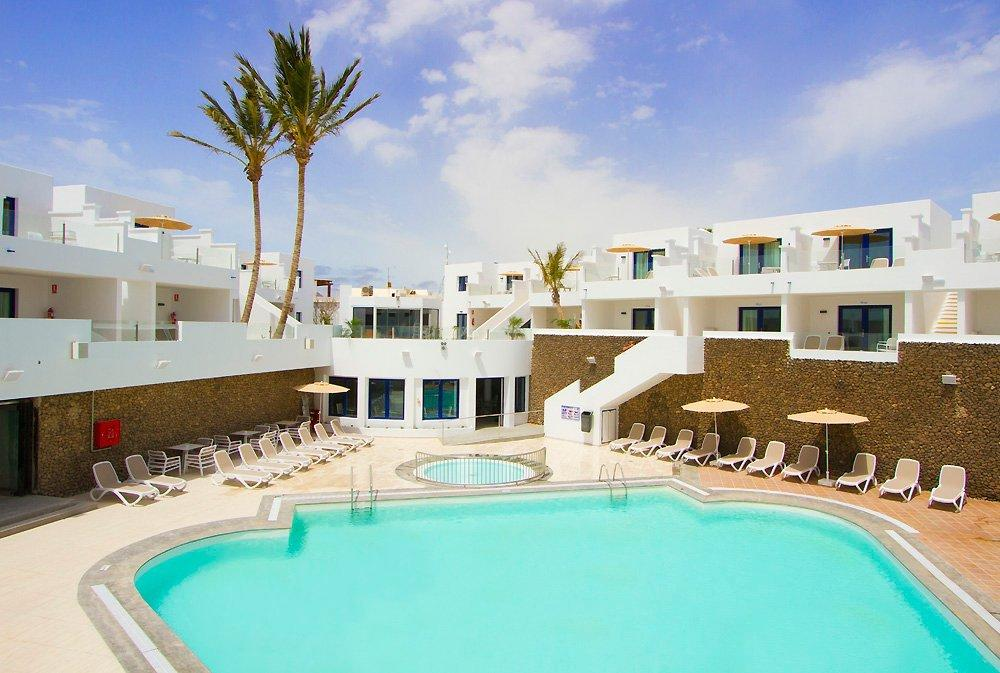 """<p>Set in Lanzarote's most popular resort, this place ticks all the right boxes for sun, sea and sand seekers. The newly refurbished Aqua Suites are a stone's throw from the hustle and bustle of Puerto del Carmen's main drag. Everything's within easy reach, with a beach just a 10-minute walk away and an 18-hole golf course a couple of minutes' drive down the road. See<a href=""""https://www.tripadvisor.co.uk/Hotel_Review-g662290-d10799554-Reviews-Aqua_Suites-Puerto_Del_Carmen_Lanzarote_Canary_Islands.html"""" target=""""_blank"""">here</a>for more.</p>"""