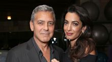 George and Amal Gift Passengers With Headphones