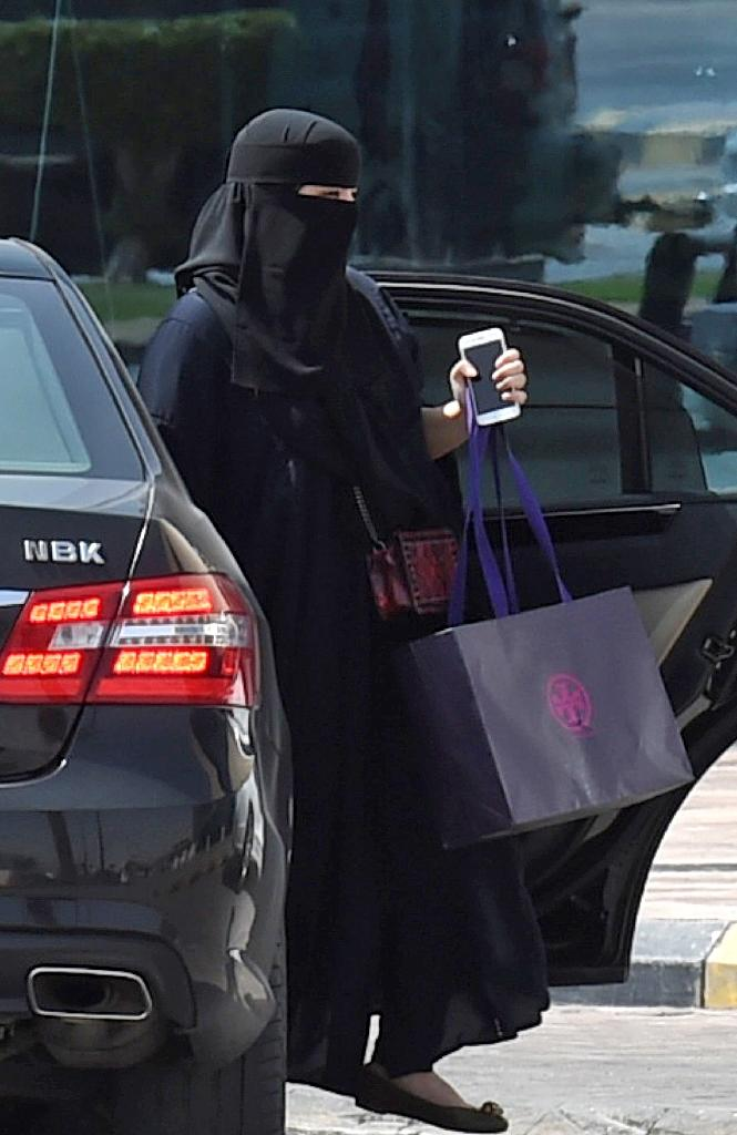 Analysts say the lifting of Saudi Arabia's unique driving ban could socially liberate the kingdom's women -- long heavily reliant on foreign drivers and ride-sharing apps to go about their daily lives (AFP Photo/FAYEZ NURELDINE)