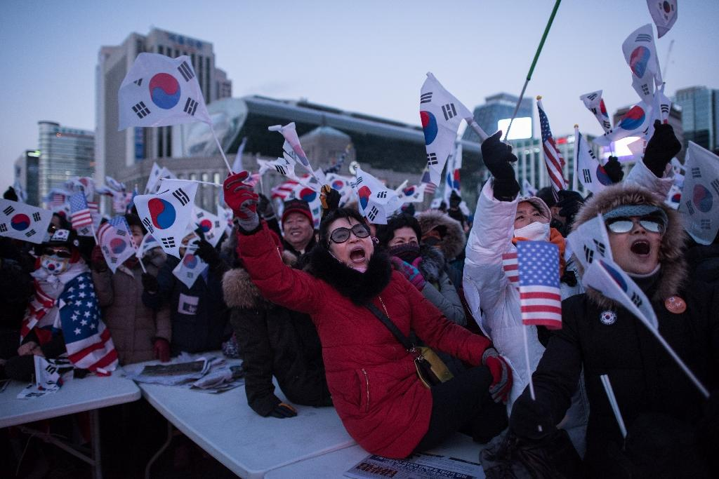 Seoul has seen months of political turmoil, with rival rallies for and against former president Park Geun-Hye (AFP Photo/Ed JONES)