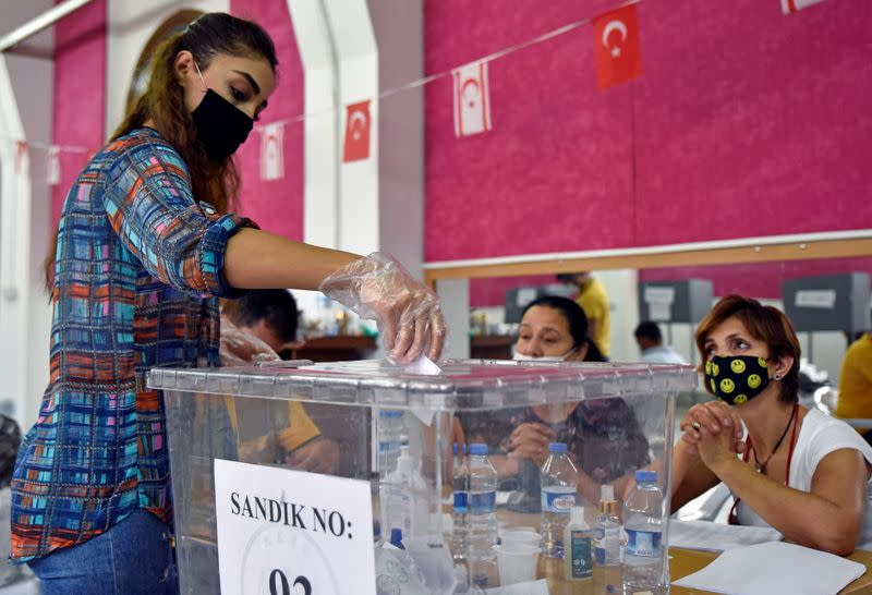 A woman casts her vote at a polling station during Turkish Cypriot presidential election in northern Nicosia