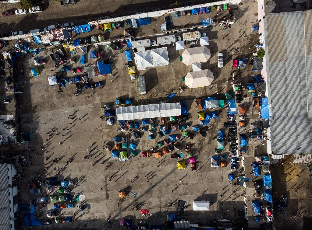 An aerial view of a new shelter in Tijuana for Central American migrants -- most of them from Honduras -- hoping to reach the United States, after a first shelter was shut down (AFP Photo/Guillermo Arias)