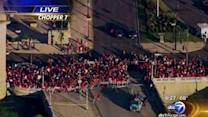 Fans line up early for Hawks parade, rally