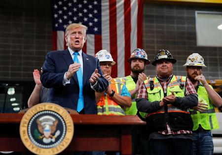 U.S. President Donald Trump is applauded prior to signing an executive order on energy and infrastructure during a campaign event at the International Union of Operating Engineers International Training and Education Center in Crosby, Texas, U.S., April 10, 2019. REUTERS/Carlos Barria