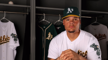 'Highly patriotic' A's catcher becomes first MLB player to kneel during anthem in response to Trump
