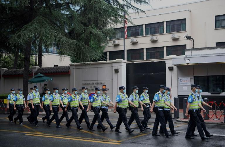 Chinese police marched outside the US consulate in Chengdu as US personnel evacuated the building (AFP Photo/Noel Celis)