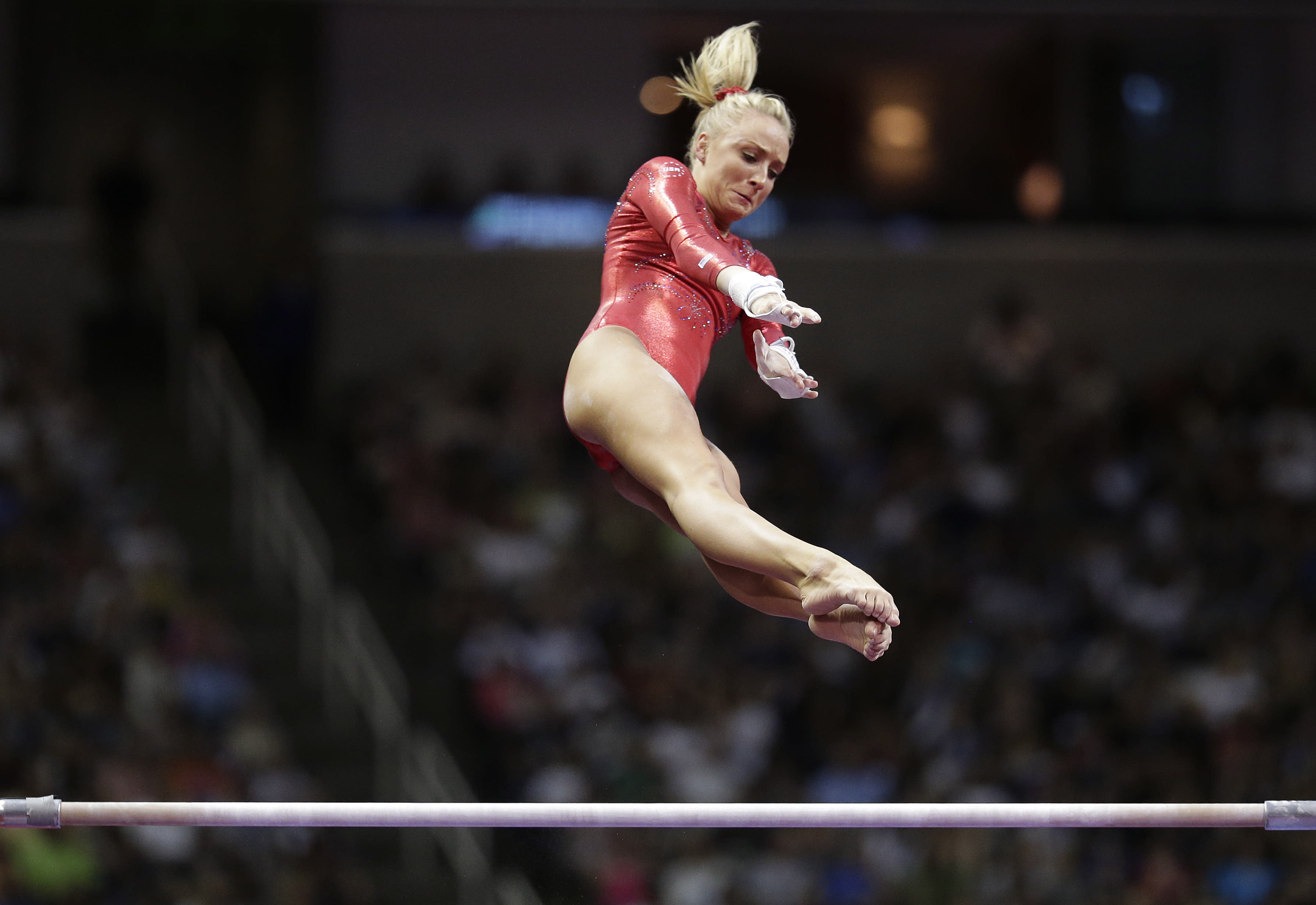Nastia Liukin performs on the uneven bars during the final round of the women's Olympic gymnastics trials, Sunday, July 1, 2012, in San Jose, Calif. (AP Photo/Jae C. Hong)