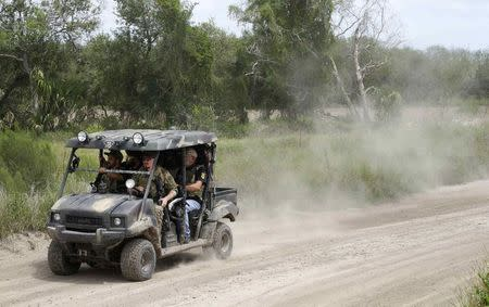 """Members of the """"Patriots"""" patrol the area in their UTV near the U.S.-Mexico border outside Brownsville, Texas September 2, 2014. REUTERS/Rick Wilking"""
