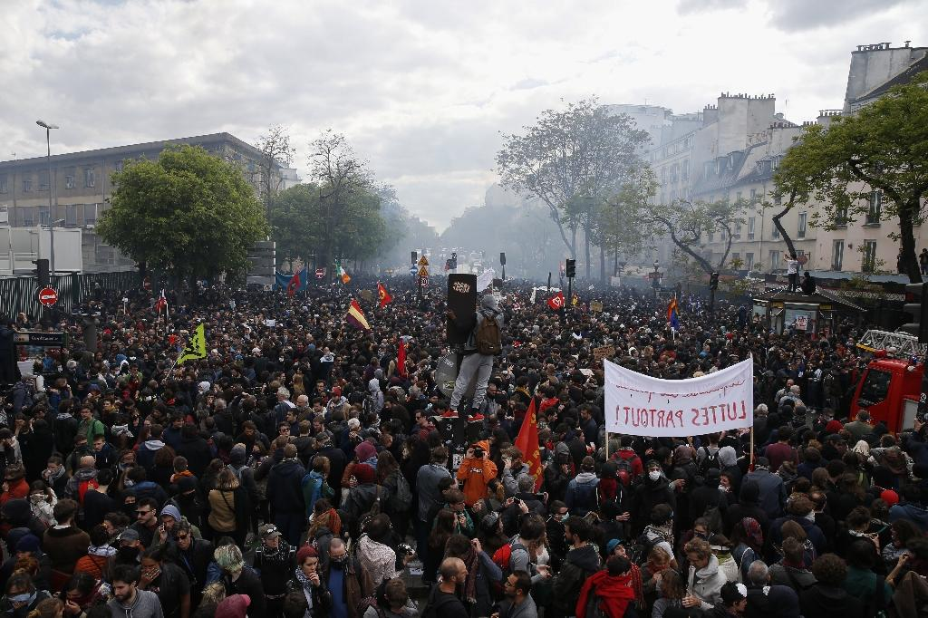 Tens of thousands of people took part in marches nationwide, including over 20,000 in Paris, the police said (AFP Photo/GEOFFROY VAN DER HASSELT)