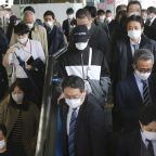 Tokyo asks drinking places to close early to curb virus rise