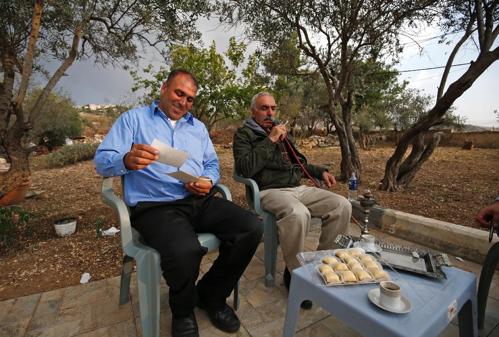 Bassam and Issa Tlaib, uncles of Palestinian-American Rashida Tlaib who was elected to the US Congress, receive well-wishers at their home in the occupied West Bank village of Beit Ur al Foqa on November 8, 2018 (AFP Photo/ABBAS MOMANI)