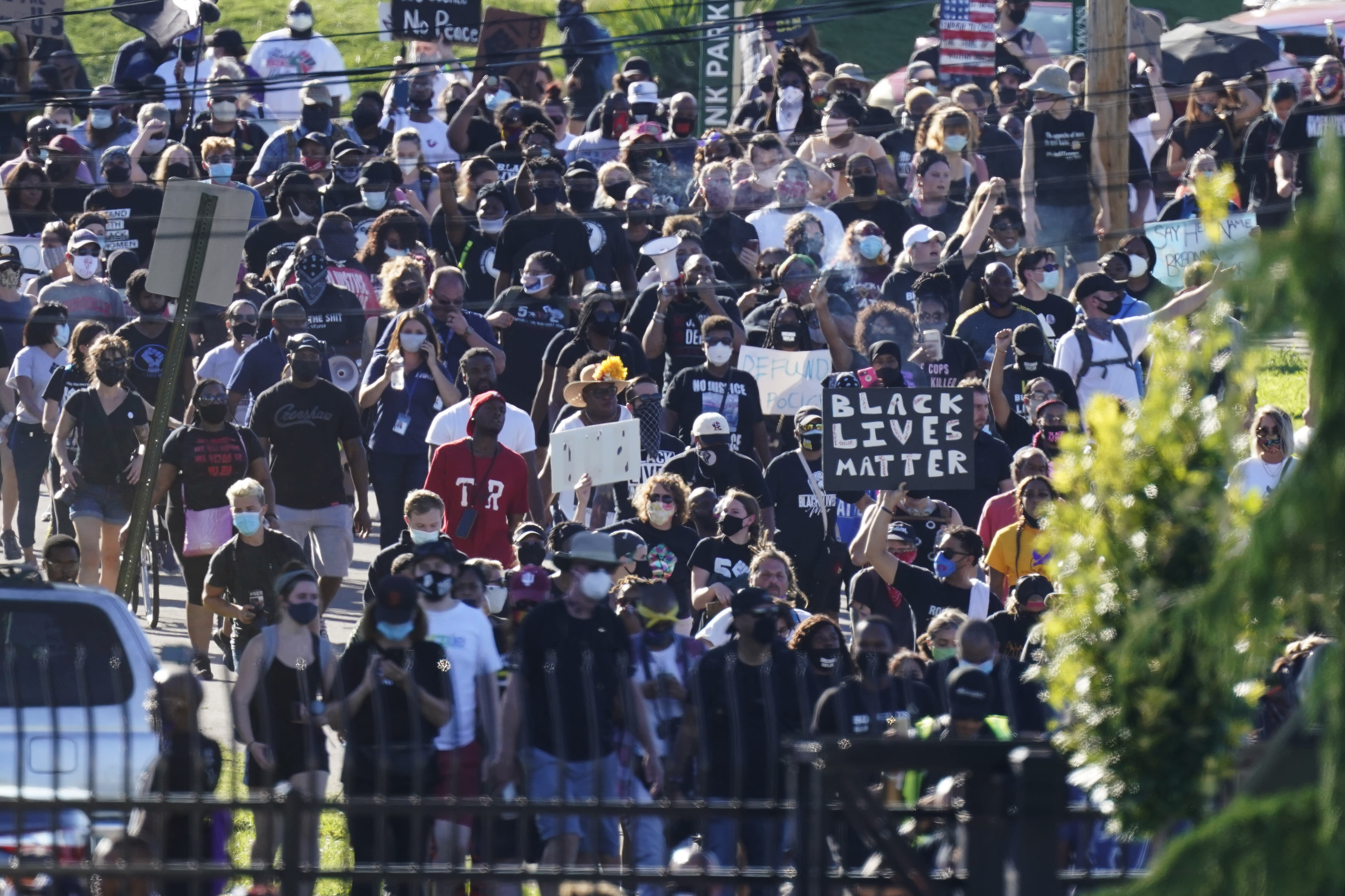 Protesters march past the gates of Churchill Downs racetrack before the 146th running of the Kentucky Derby, Saturday, Sept. 5, 2020, in Louisville, Ky. (AP Photo/Charlie Riedel)