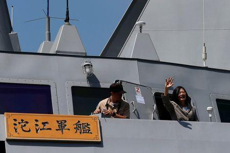 Taiwanese President Tsai Ing-wen waves her hand as she boards the nation's first domestically built stealth-missile 500-ton Tuo Jiang twin-hull corvette at Suao Naval Base in Yilan, Taiwan