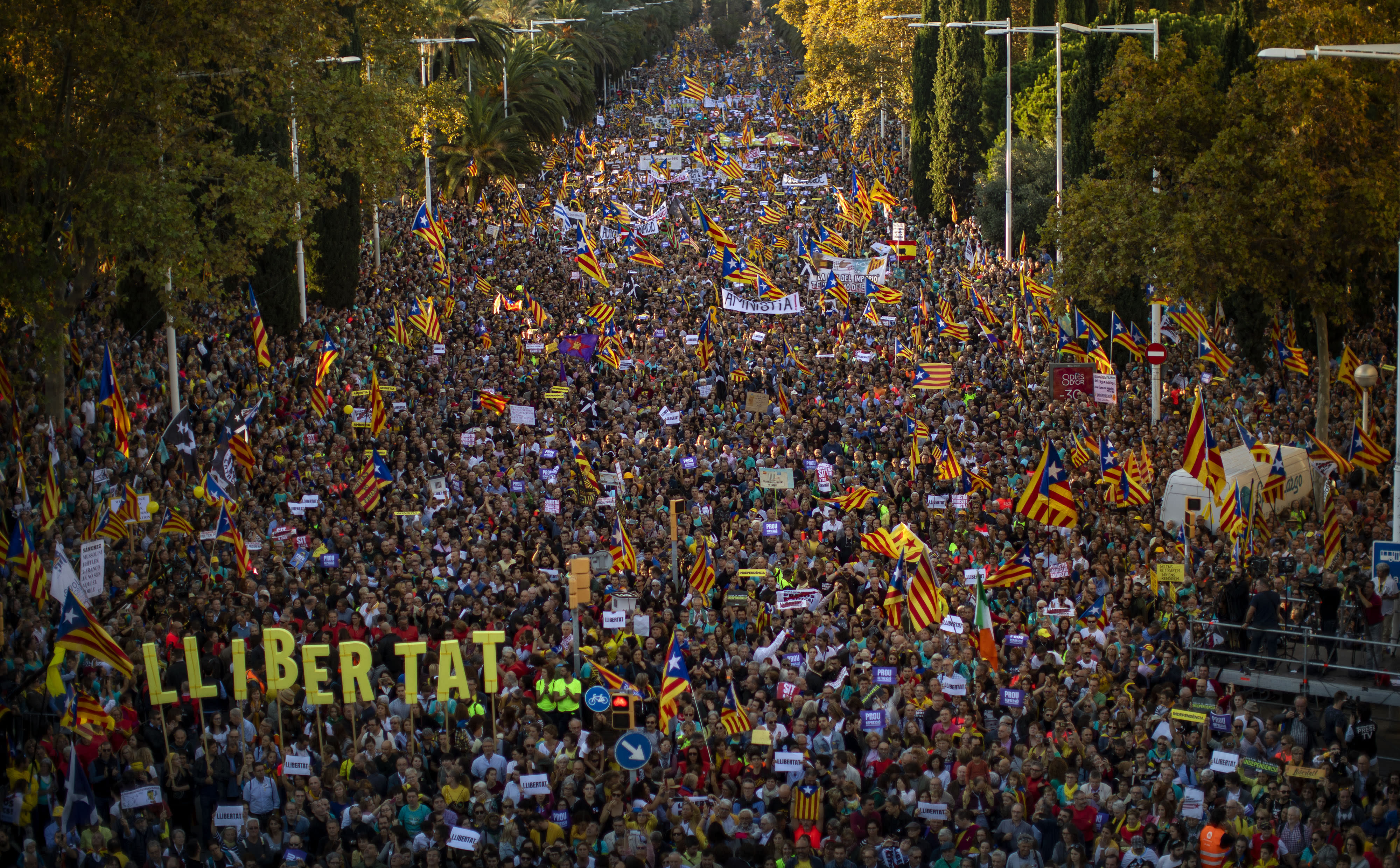 Catalan pro-independence protesters gather during a demonstration in Barcelona, Spain, Saturday, Oct. 26, 2019. Protests turned violent last week after Spain's Supreme Court convicted 12 separatist leaders of illegally promoting the wealthy Catalonia region's independence and sentenced nine of them to prison. (AP Photo/Emilio Morenatti)