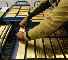 Gold rises on wobbly dollar; stocks surge after U.S. government shutdown ends