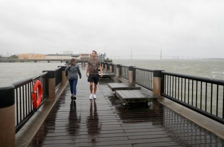 Lindsey Garfinkel and Justin Walczuk of Charleston, check out the wind and rain on the waterfront ahead of the arrival of Hurricane Dorian in Charleston