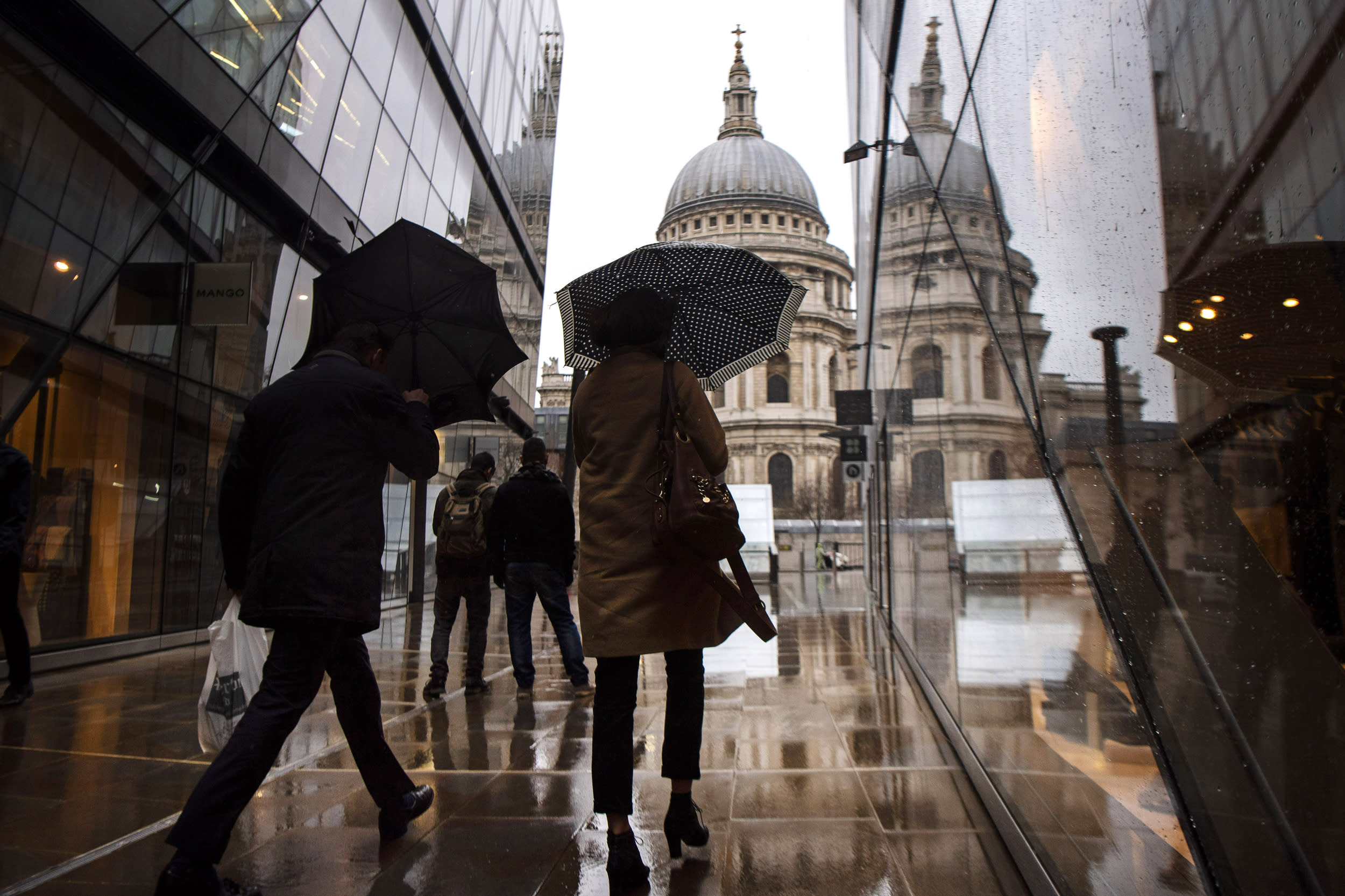 Shoppers brave the strong winds and rain near St Paul's Cathedral in central London, as Storm Erik brought strong winds to parts of the country.