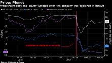 Hedge Fund Titans Aurelius and Elliott Clash in Distressed Deal