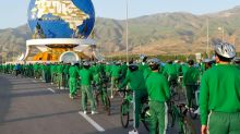 Back in the saddle: Turkmen leader heads up giant bike parade