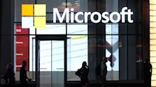 US STOCKS-Wall St edges higher on Microsoft's beat, rate cut optimism