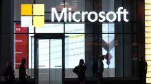 US STOCKS-Wall St edges higher on Microsoft's beat, rate cut optimism