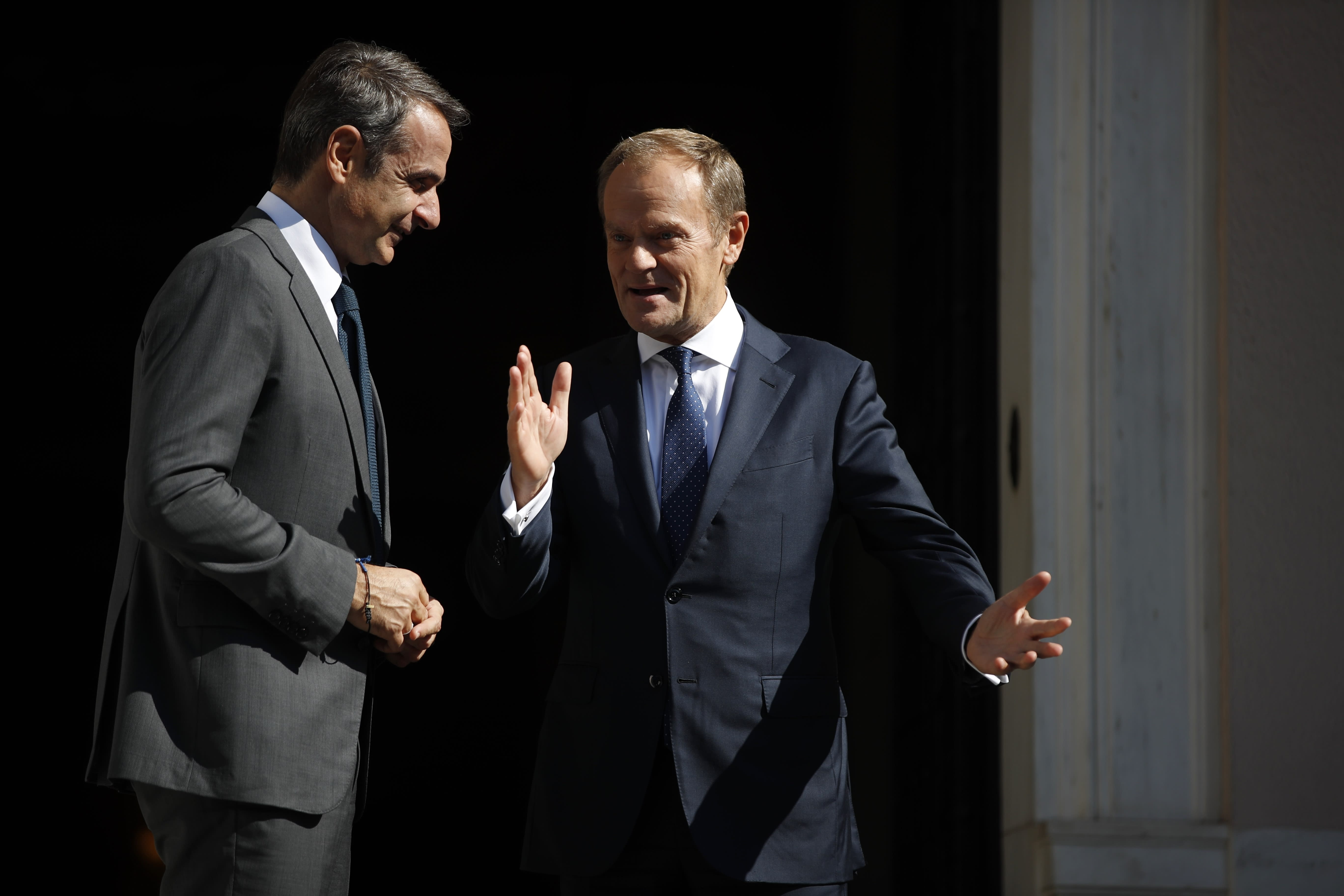 """European Council President Donald Tusk, right, speaks with Greece's Prime Minister Kyriakos Mitsotakis during their metering at Maximos Mansion in Athens, Wednesday, Oct. 9, 2019. EU leaders have demanded more """"realism"""" from Britain in response to a Brexit plan proposed by British Prime Minister Boris Johnson. (AP Photo/Thanassis Stavrakis)"""