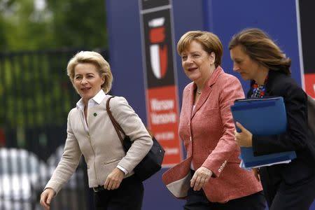 German Chancellor Angela Merkel (C) and German Defence Minister Ursula von der Leyen (L) arrive for the NATO Summit in Warsaw, Poland July 9, 2016. REUTERS/Kacper Pempel