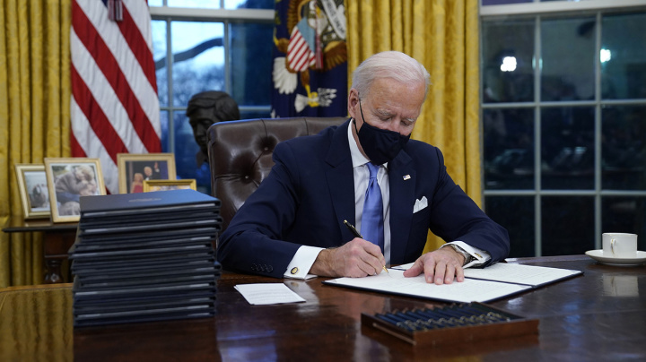 Biden signs executive orders on pandemic, climate