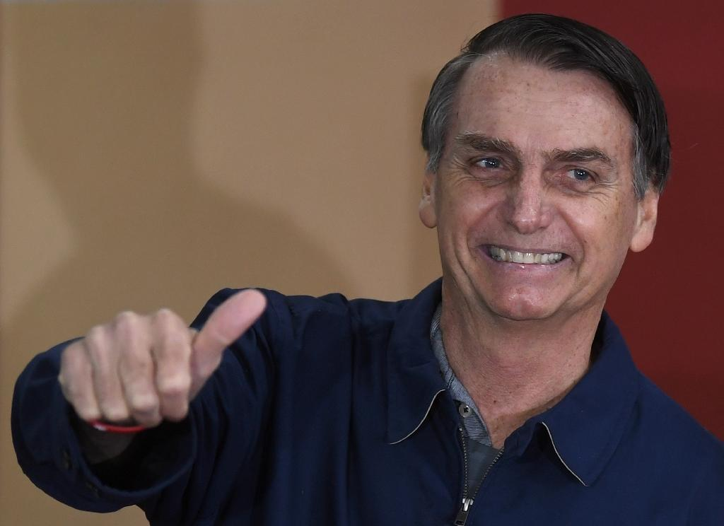 Jair Bolsonaro's lead seems insurmountable over his leftist rival Fernando Haddad (AFP Photo/Mauro PIMENTEL)